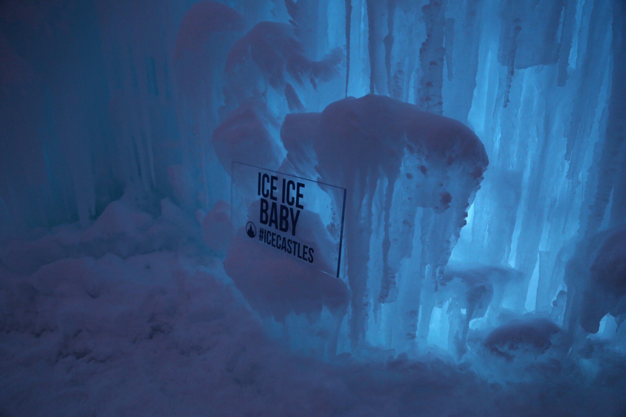 Guests come to the Ice Castles in Lake Geneva, WI at night
