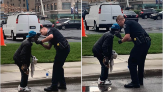 DPD officer helping man shave