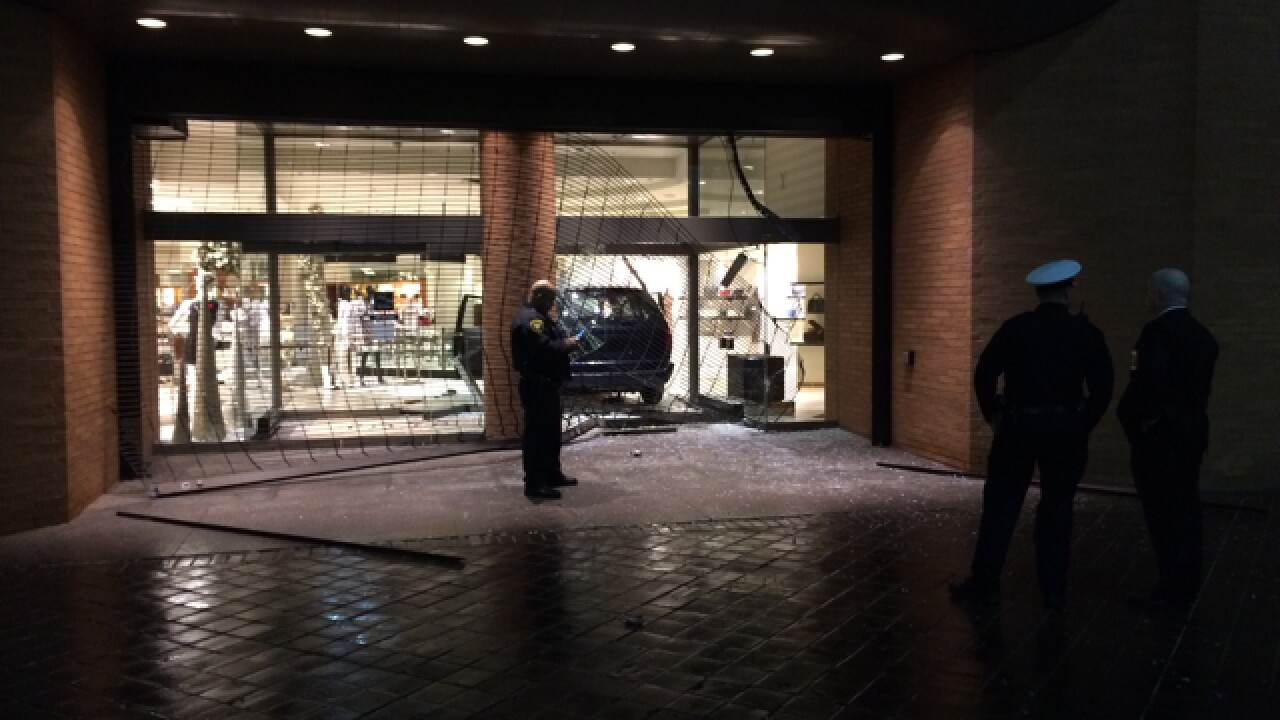 Van crashes into Saks Fifth Ave. during robbery