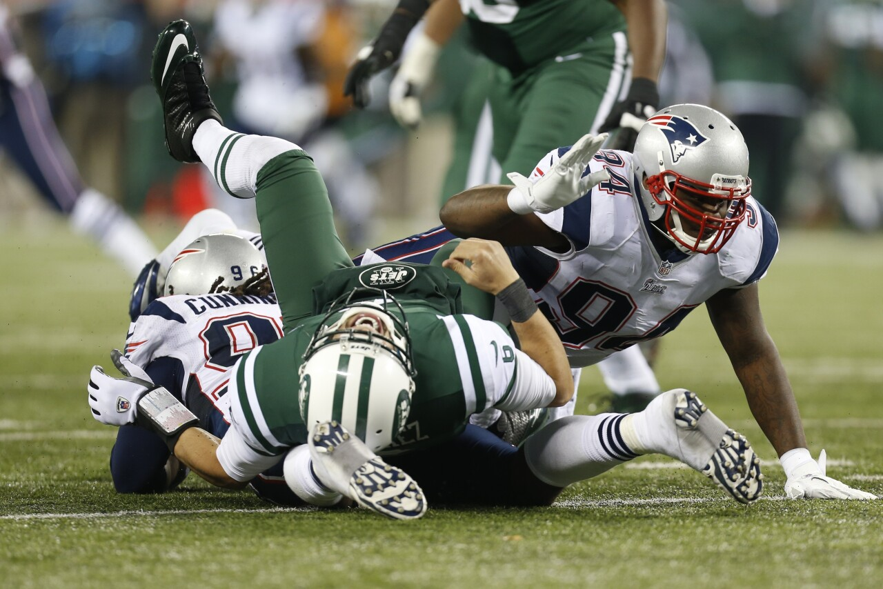 New York Jets QB Mark Sanchez hit by New England Patriots on Thanksgiving in 2012