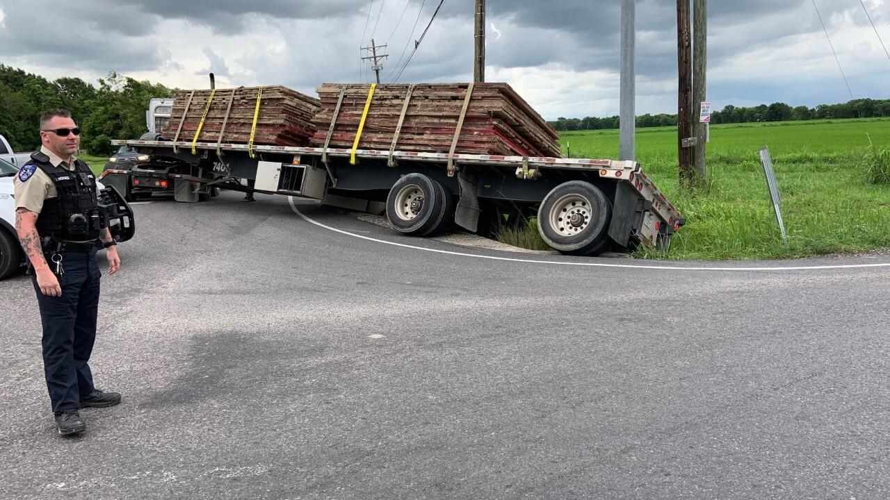 Truck in Duson carrying wood.jpg