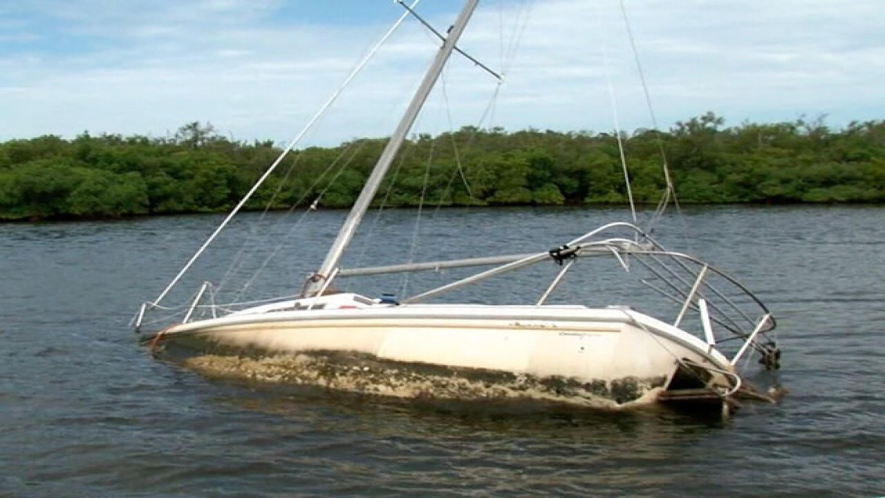 Derelict boats littering Tampa Bay waterways