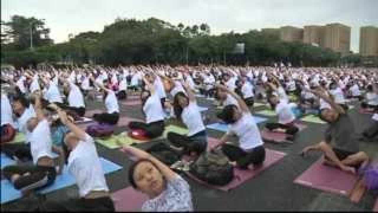 Crowd of 7,000 gather for outdoor yoga event