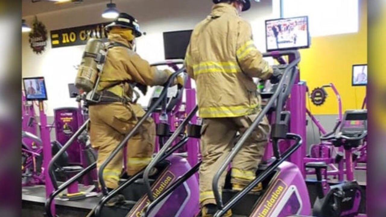 Firefighters in full gear walked up 110 flights of stairs to honor those who died on 9/11