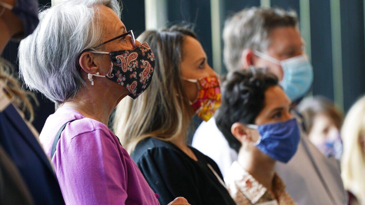 People wearing masks at Denver Zoo