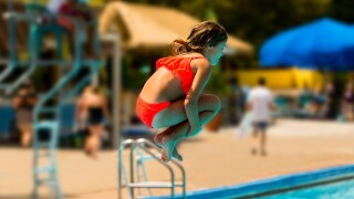 Girl doing cannonball