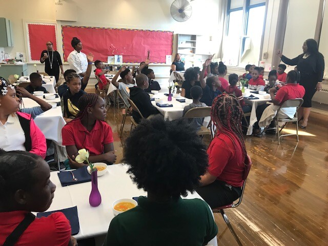 Teacher leads etiquette class