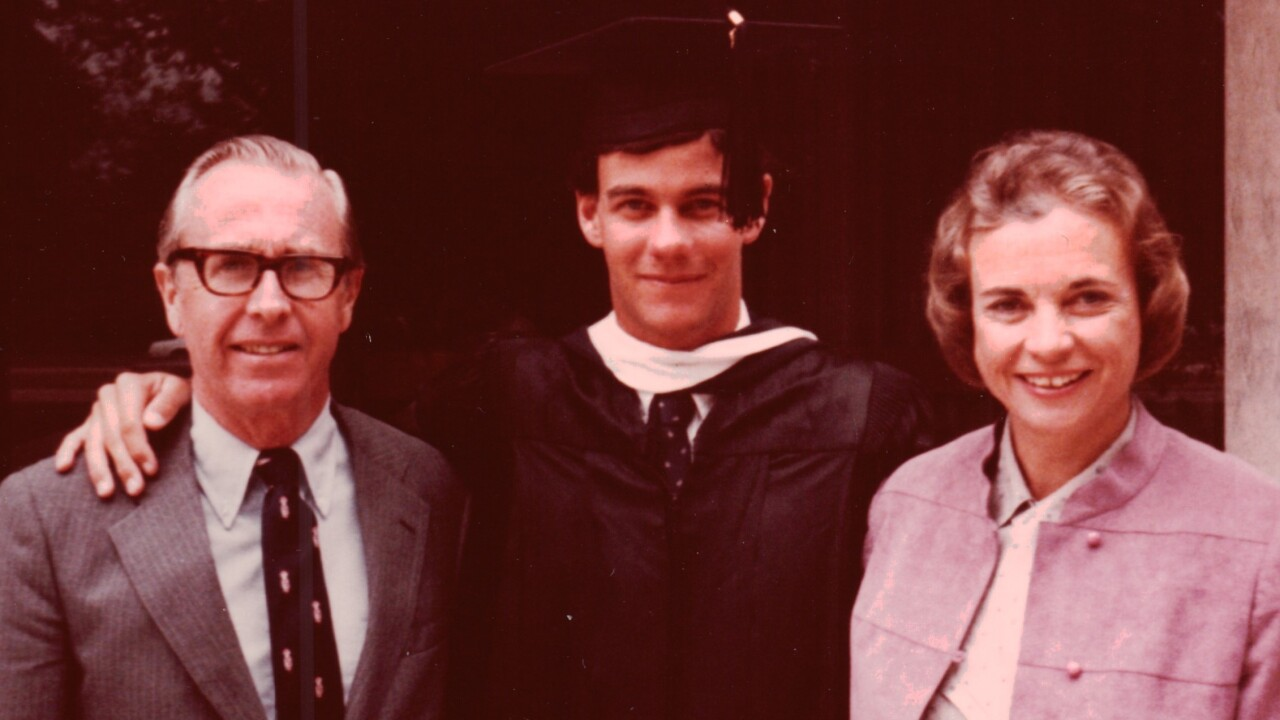 Brian Day O'Connor with his parents at his graduation from Colorado College in 1982