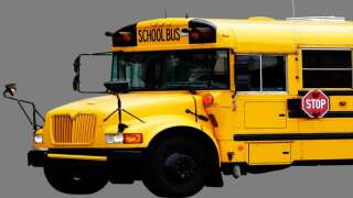 Driver crashes into school bus, leaves scene in Fountain