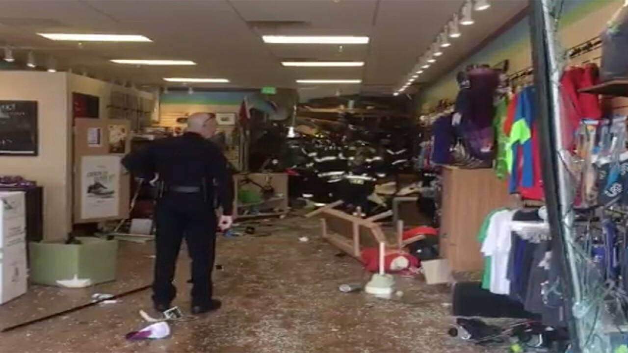 6 hurt when car crashes into building in Parker