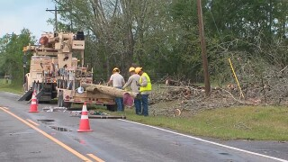Crews work to clean up following severe weather in Mississippi.