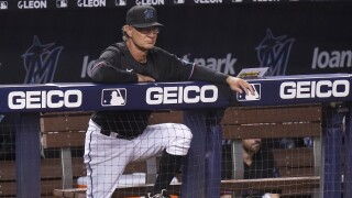 Miami Marlins manager Don Mattingly watches from dugout, July 23, 2021
