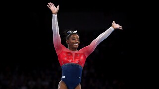 Simone Biles of USA waves to the crowd after finishing her floor routine during the Women's Team Finals on Day 5 of FIG Artistic Gymnastics World Championships on October 08, 2019 in Stuttgart, Germany.