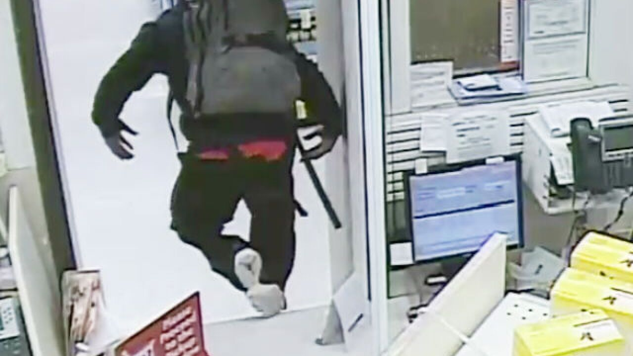 PD: Robber jumps pharmacy counter, pulls gun