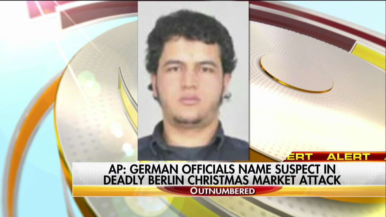 Berlin attack: Police hunt Tunisian suspect after finding ID papers in truck