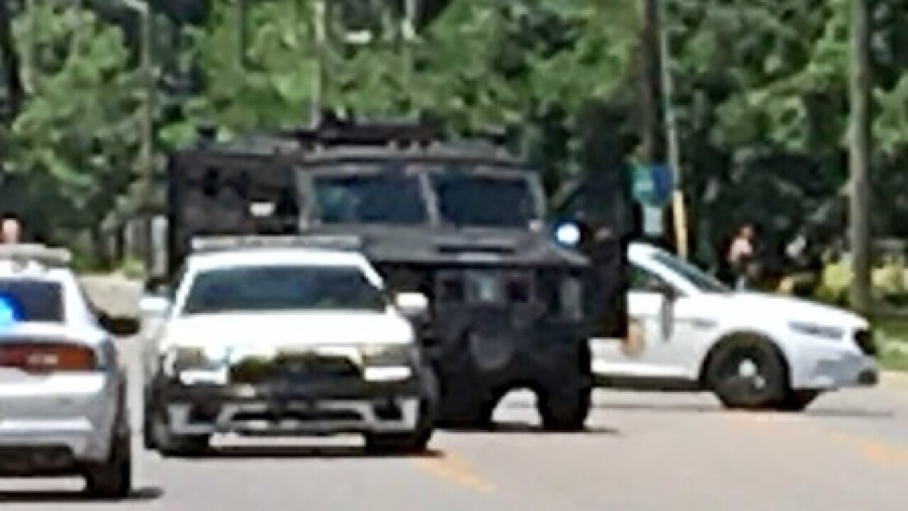 PHOTOS: Police in standoff with shooting suspect