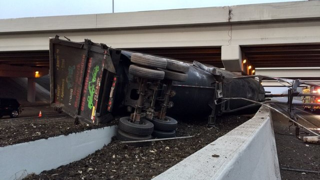 Semi flips off of I-75 onto Fowler, no injuries