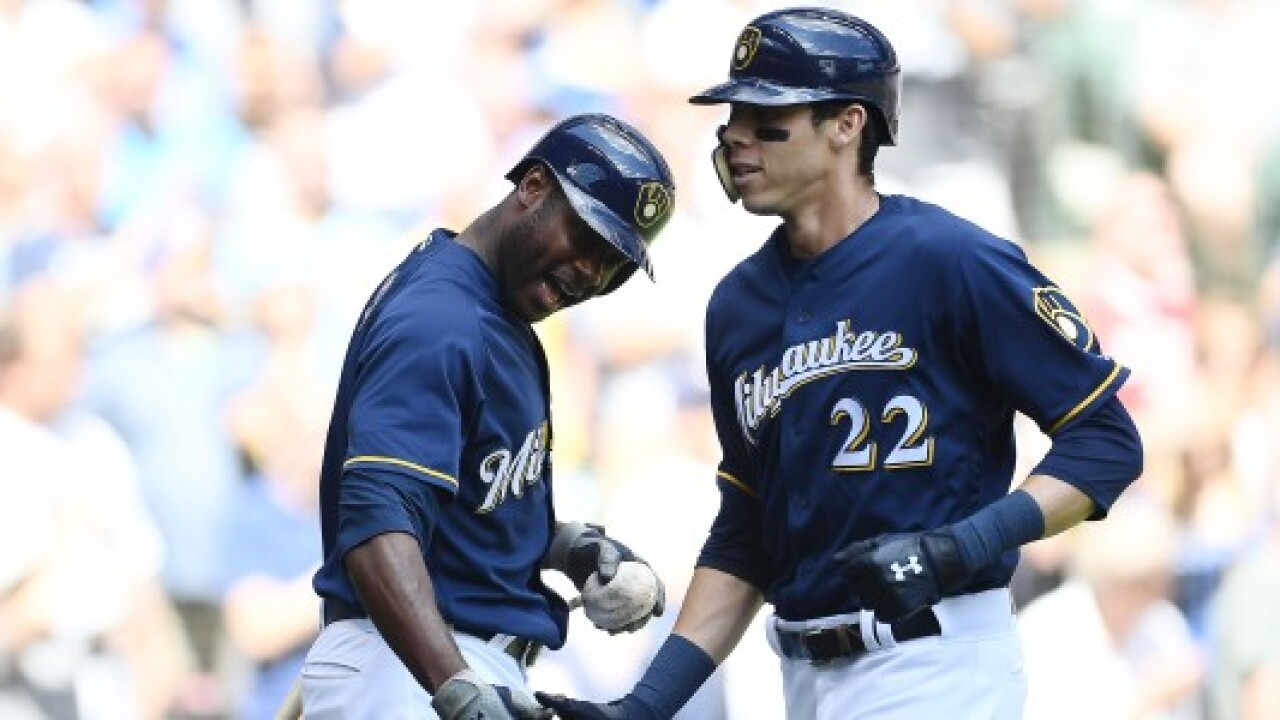 Lorenzo Cain, left, and Christian Yelich hope to lead the Brewers to another playoff berth in 2019