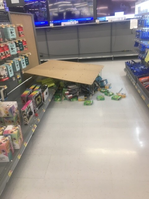 Electronics display shelf toppled over during looting at Walmart