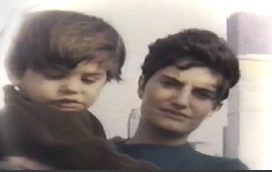Steve Villanueva's mother with Sergio in front of incomplete World Trade Center