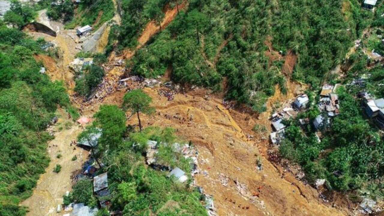 New landslide kills 21, buries houses in Philippines