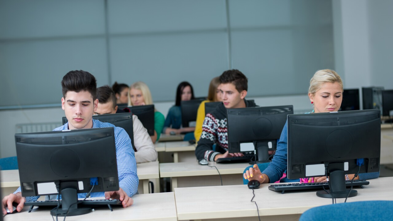 students group in computer lab classroom
