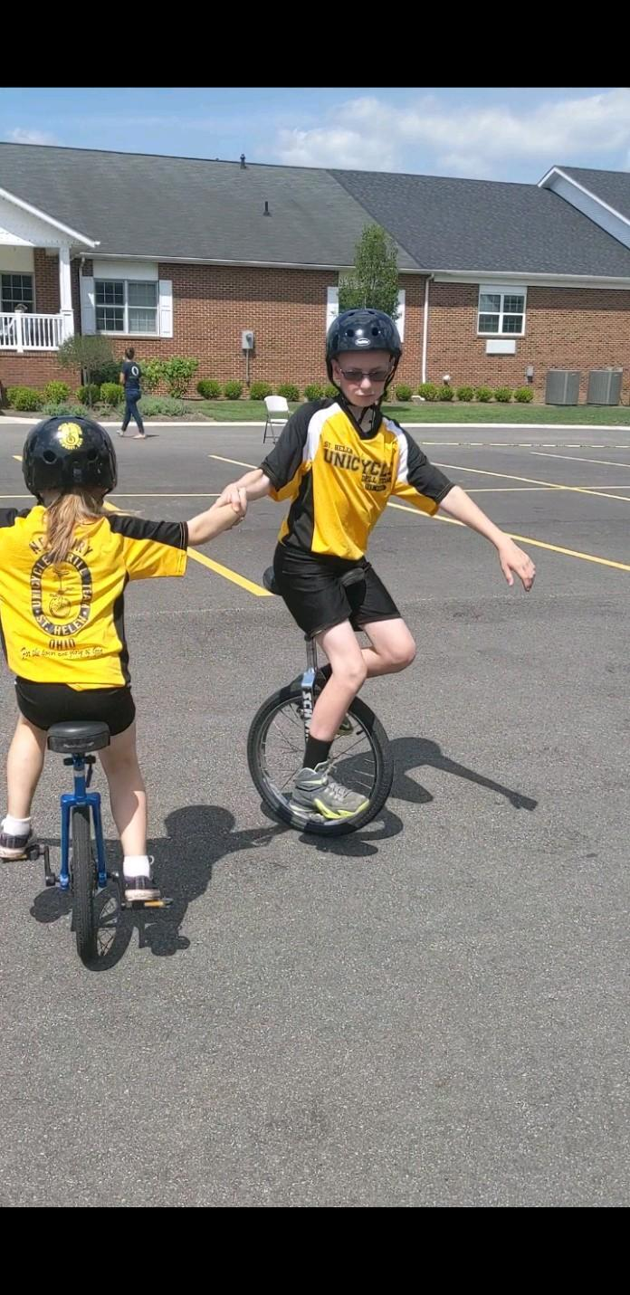 Conner practices for his unicycle drill team.