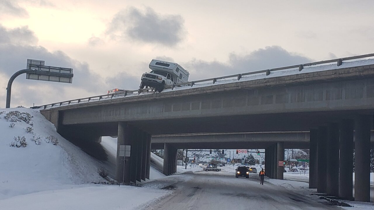 Suspected drunk driver in pickup truck camper almost slides off I-70 overpass in Colorado