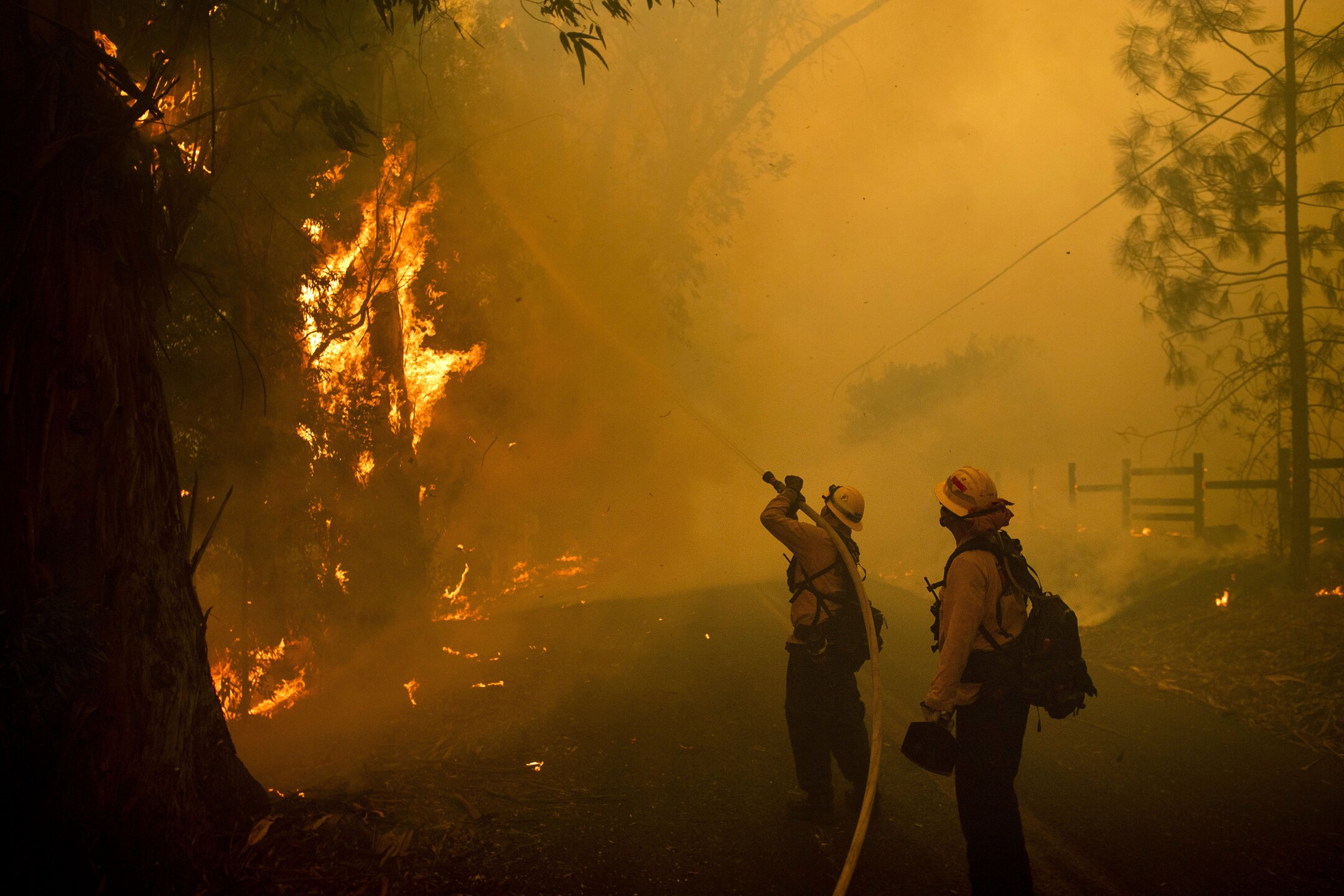 Photos: Wildfires rage in California, causing evacuations and power outages