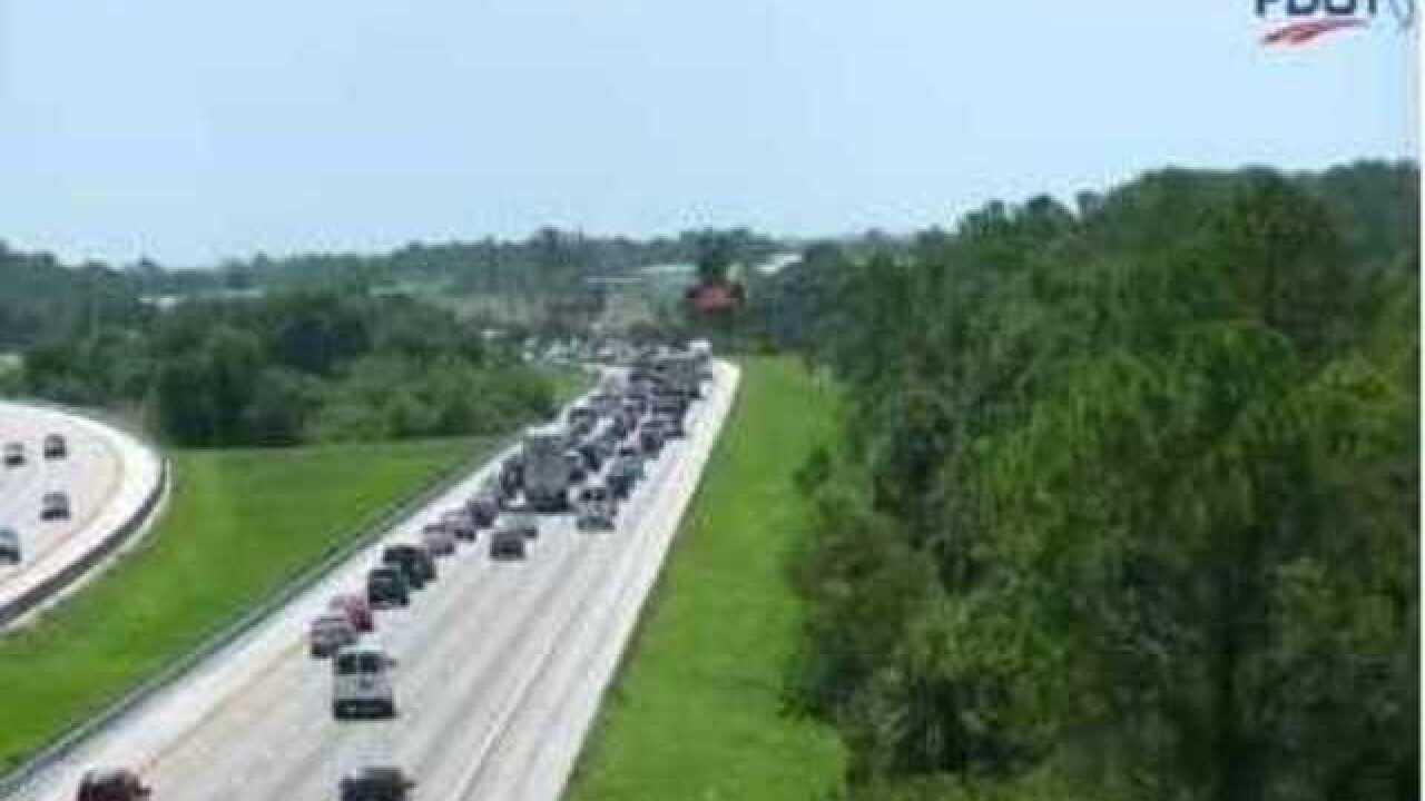 Car catches on fire on I-75 shutting down lanes