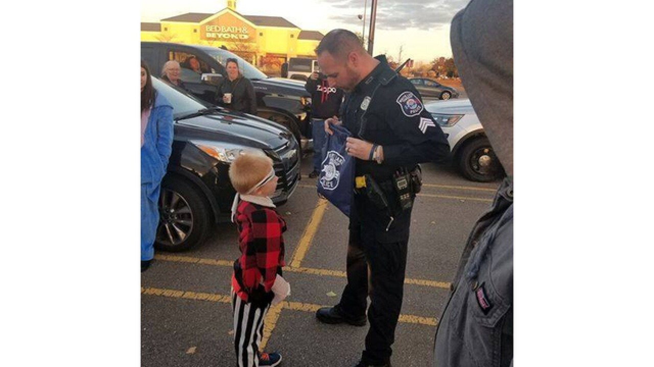 Neighbors in White Lake Township organize 'trunk-or-treat' for little boy who was bitten by a dog