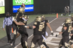 Jaylen Hall celebrates the go-ahead touchdown after the fake spike