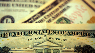 Schools meet 'In God We Trust' requirement with $1 bill