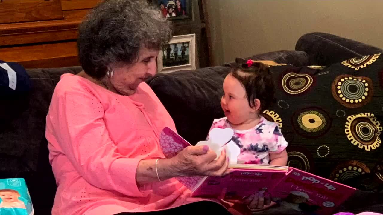 Joyce Fish reads book to her great-granddaughter