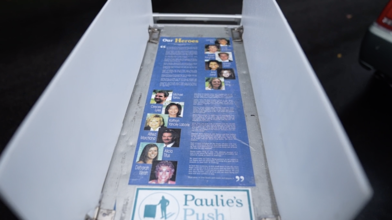 On the airline beverage cart that Paul Veneto is pushing are photos of flight crews from the planes that were hijacked on 9/11. He is walking the cart from Boston to Ground Zero in New York City - a journey of more than 200 miles.