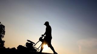 Man mows grass in 50 states