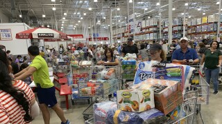 Florida shoppers wait in line at Costco in Davie with hurricane supplies ahead of Hurricane Dorian in 2019