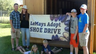 Manhattan couple to host shoe drive to help with adoption costs