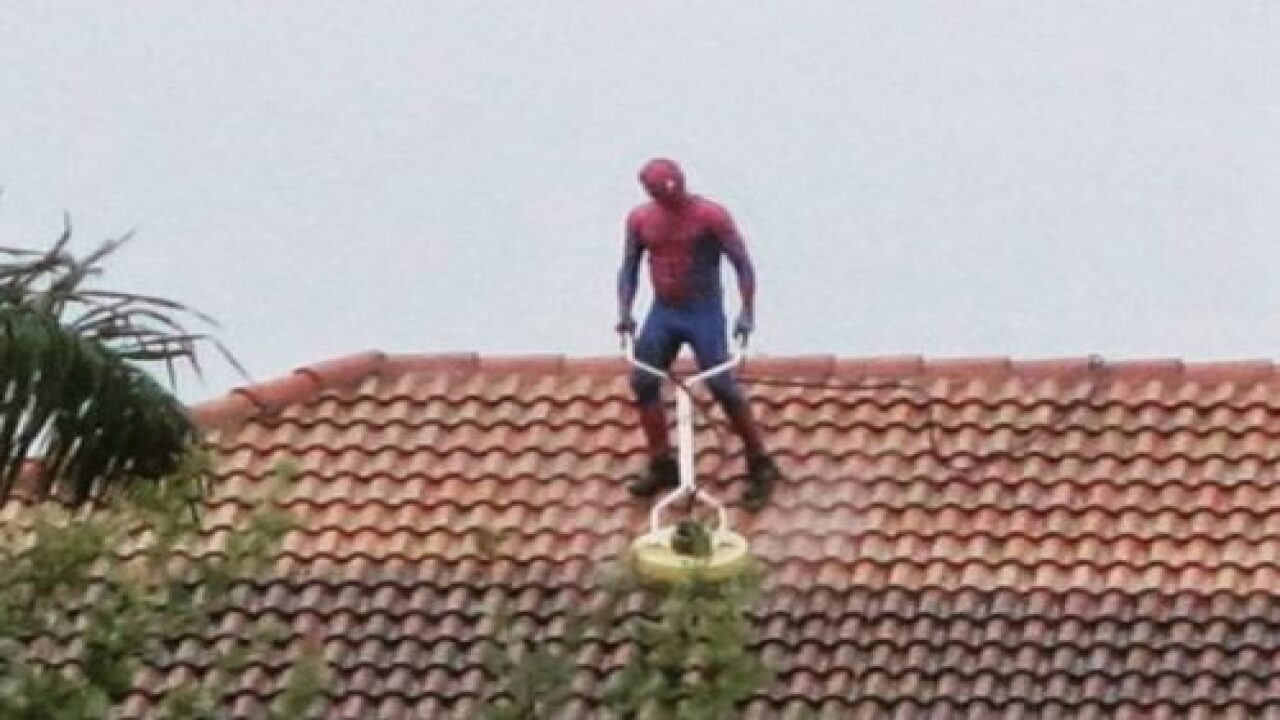 'Spider-Man' Was Spotted Pressure-washing A Roof During A Rainstorm