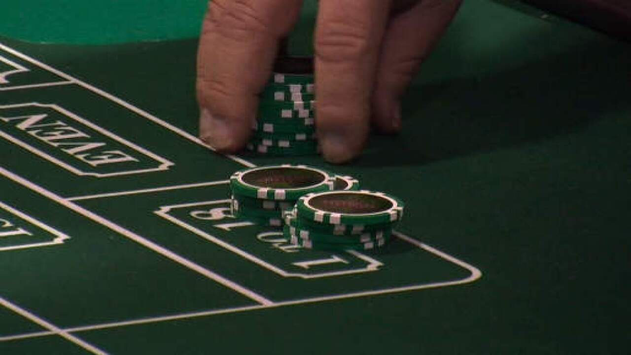Casino dealer, 6 others charged in money scheme