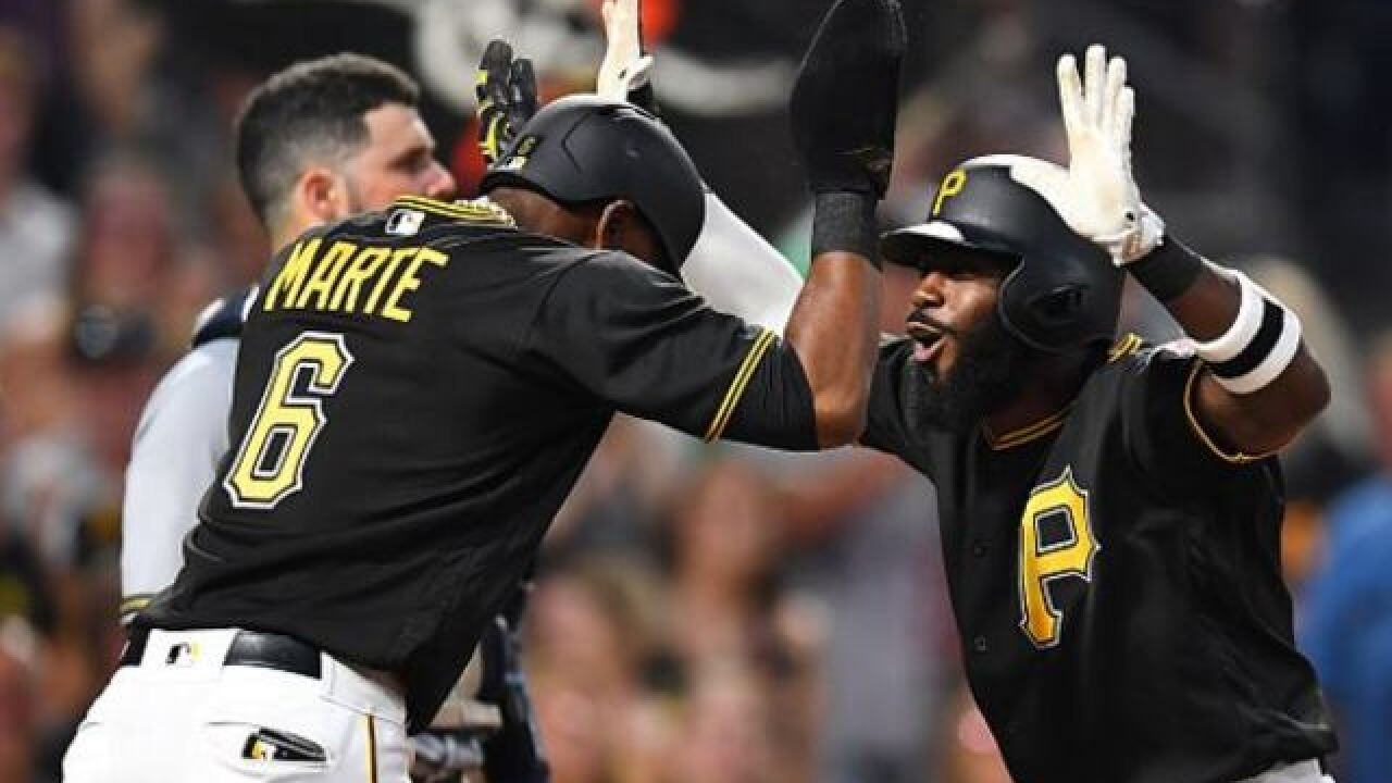 Pirates rally past Brewers 4-3 in Marte's return