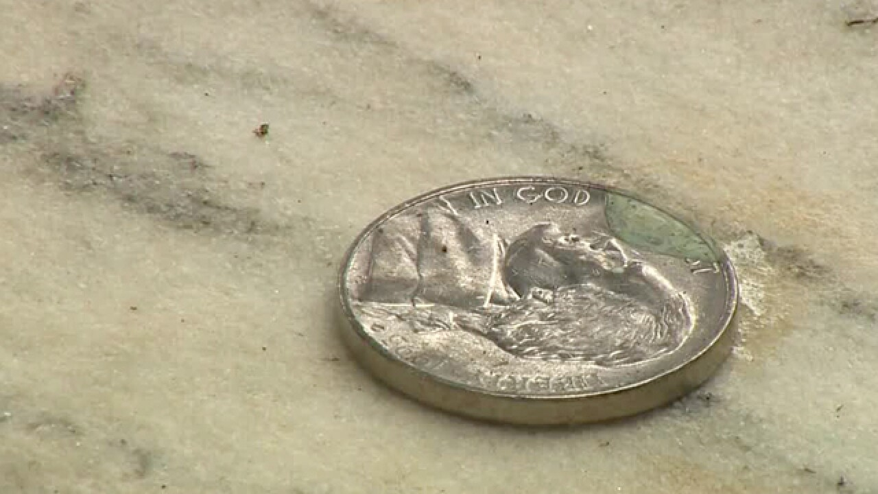Learn What Coins Left On Soldiers' Tombstones Mean