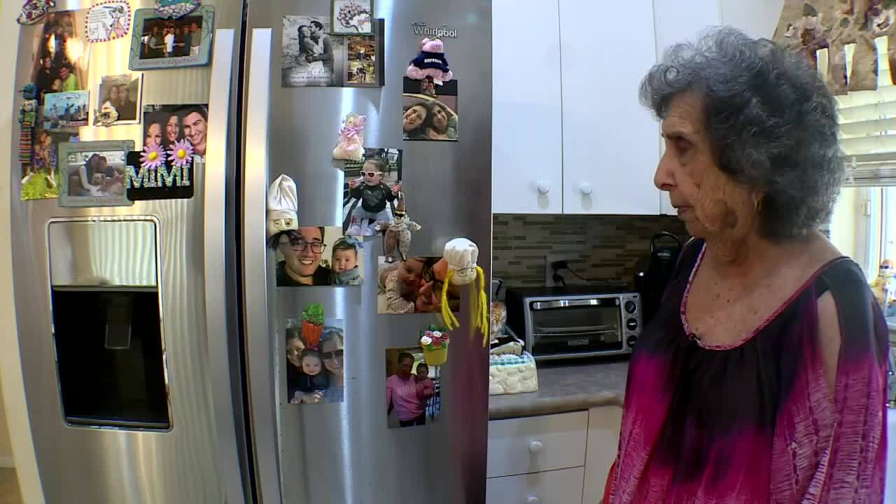 Joyce Fish looks at pictures of her great-granddaughter on refrigerator at her Boynton Beach home