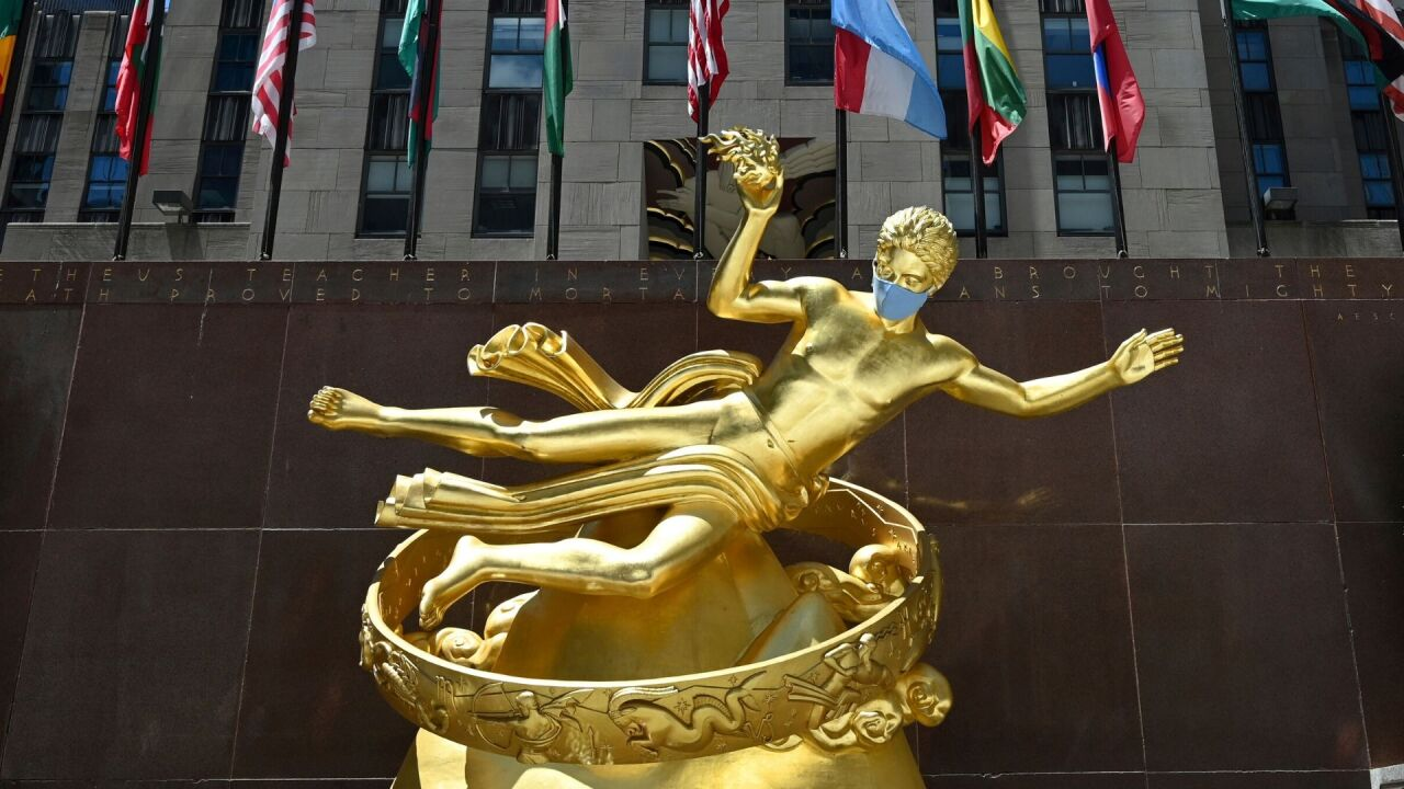 Rockefeller Center statues dressed to wear masks in NYC