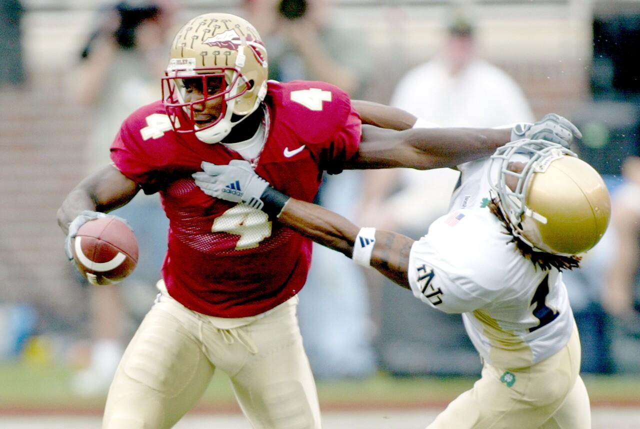 Florida State Seminoles receiver Anquan Boldin stiff arms Notre Dame Fighting Irish cornerback Preston Jackson in 2002