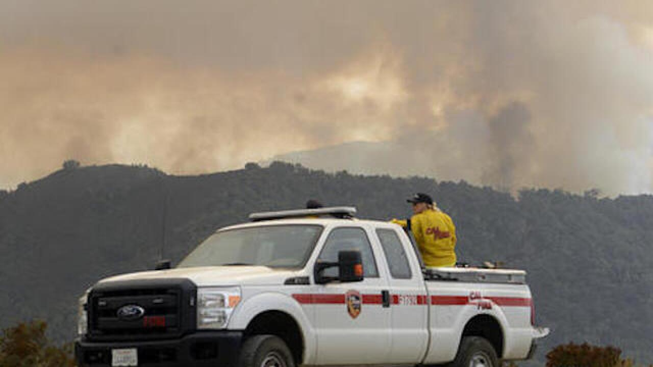 Wildfires burn in 7 Western states, force evacuations