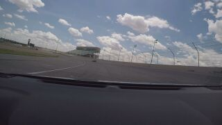 Cars drive on track at Pikes Peak International Raceway. Courtesy of PPIR.