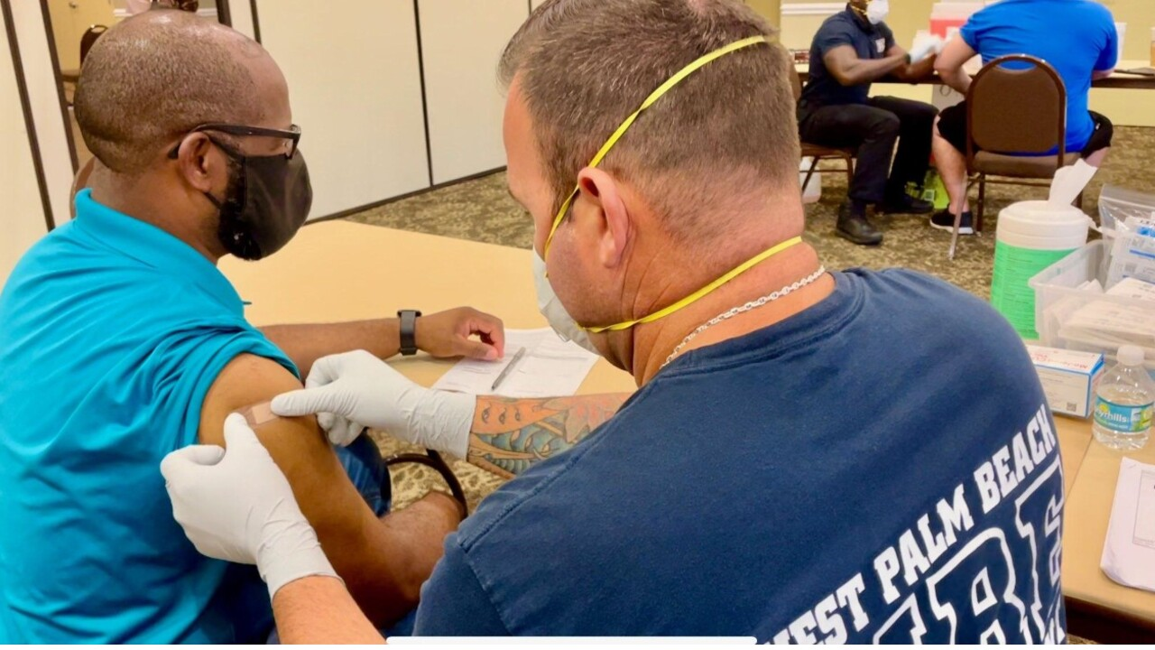 A patient receives the COVID-19 vaccine in West Palm Beach on April 1, 2021.jpg