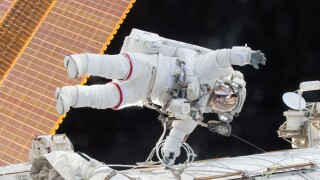 Astronauts continue space walk this morning