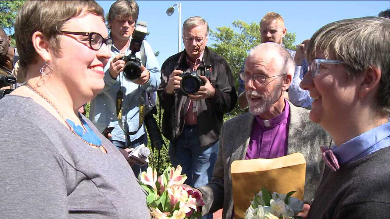 Same-sex couple exchanges marriage vows in ceremony outside Richmond court